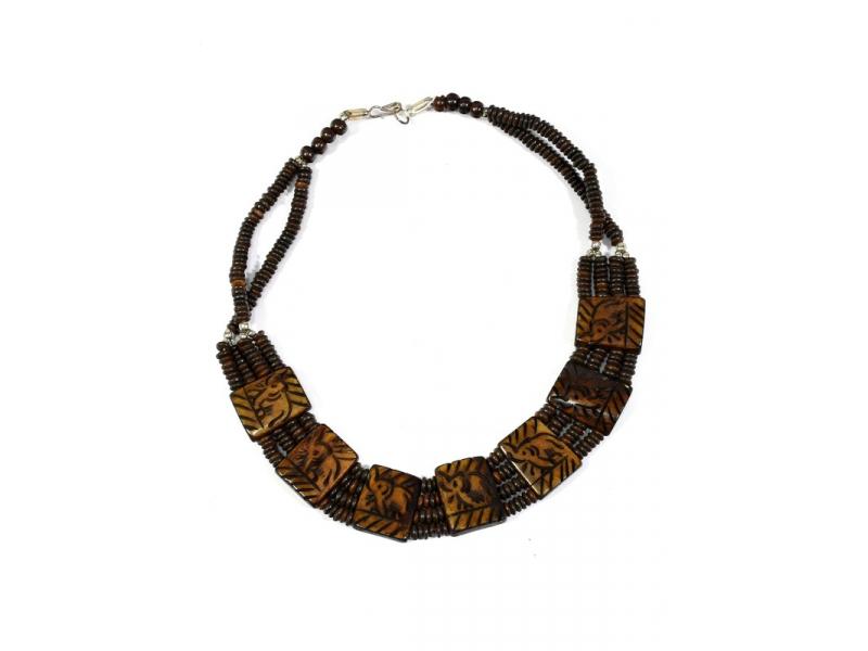Tmavě hnědý kostěný náhrdelník s motivem slonů